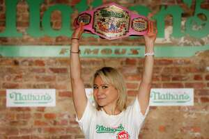 Competitive eater Miki Sudo celebrates after setting the women's world record of 48 and a half hot dogs to win the women's division of the Nathan's Famous July Fourth hot dog eating contest, Saturday, July 4, 2020, in the Brooklyn borough of New York. (AP Photo/John Minchillo)