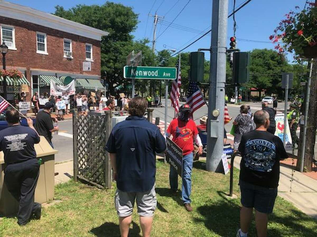 Competing rallies are conducted at a Bethlehem intersection on Saturday, July 4, 2020.