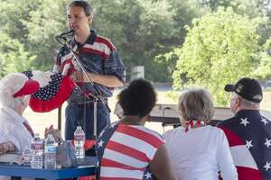 Eliel Rosa, with the Nehemiah School of Government, organized the event and welcomes everyone before members of the community read the Declaration of Independence 07/04/2020 morning at the Hogan Park Pavilion to celebrate the Fourth of July. Tim Fischer/Reporter-Telegram