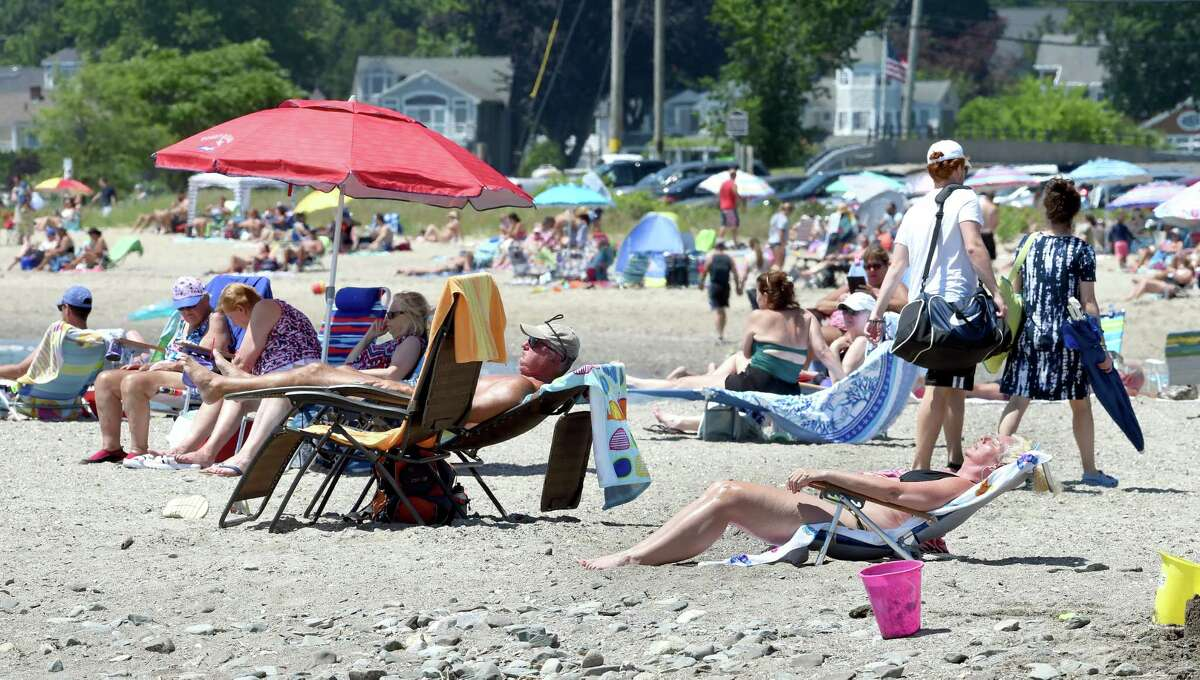 People escape the heat at Gulf Beach in Milford on July 4, 2020.