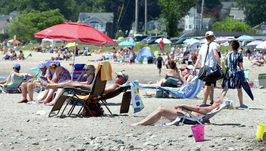 People escape the heat at Gulf Beach in Milford on July 4, 2020. Photo: Arnold Gold, Hearst Connecticut Media / New Haven Register