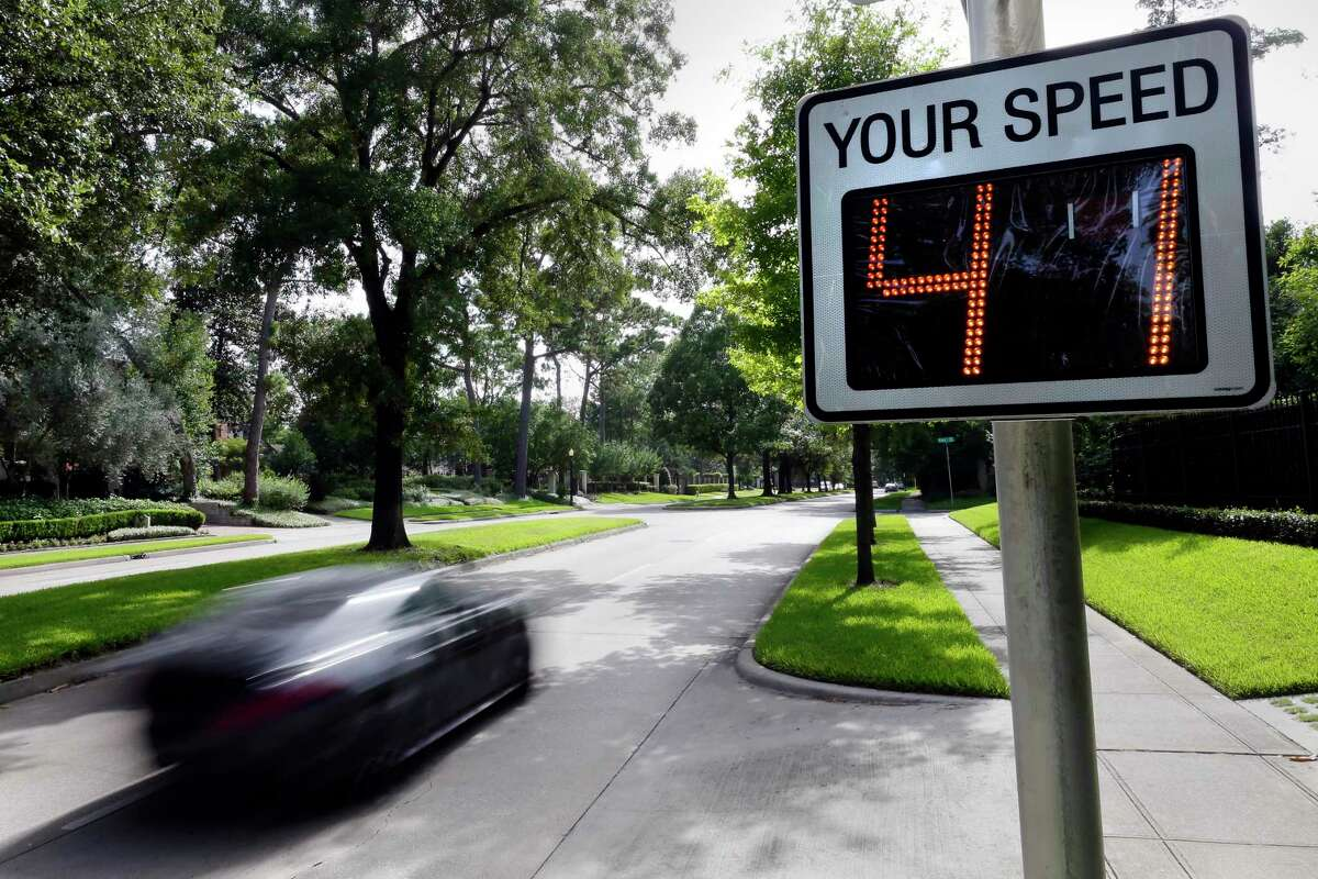 Traffic moves westbound by a speed warning sign in River Oaks along Kirby, just west of Shepard Friday, Jul. 3, 2020 in Houston, TX.