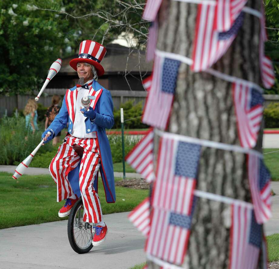 Roly Gutierrez rides a unicycle dressed a Uncle Sam on Saturday in Shenandoah. Photo: Jason Fochtman, Houston Chronicle / Staff Photographer / 2020 © Houston Chronicle