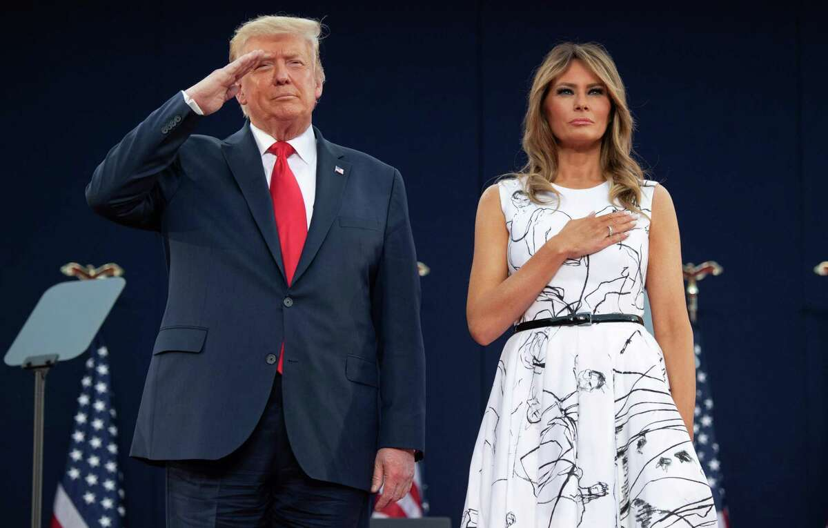 US President Donald Trump and First Lady Melania Trump pay their respects as they listen to the National Anthem during the Independence Day events at Mount Rushmore National Memorial in Keystone, South Dakota, July 3, 2020. On Oct. 2, 2020, the president tweeted that he and the First Lady tested positive for coronavirus. (Photo by SAUL LOEB / AFP) (Photo by SAUL LOEB/AFP via Getty Images)