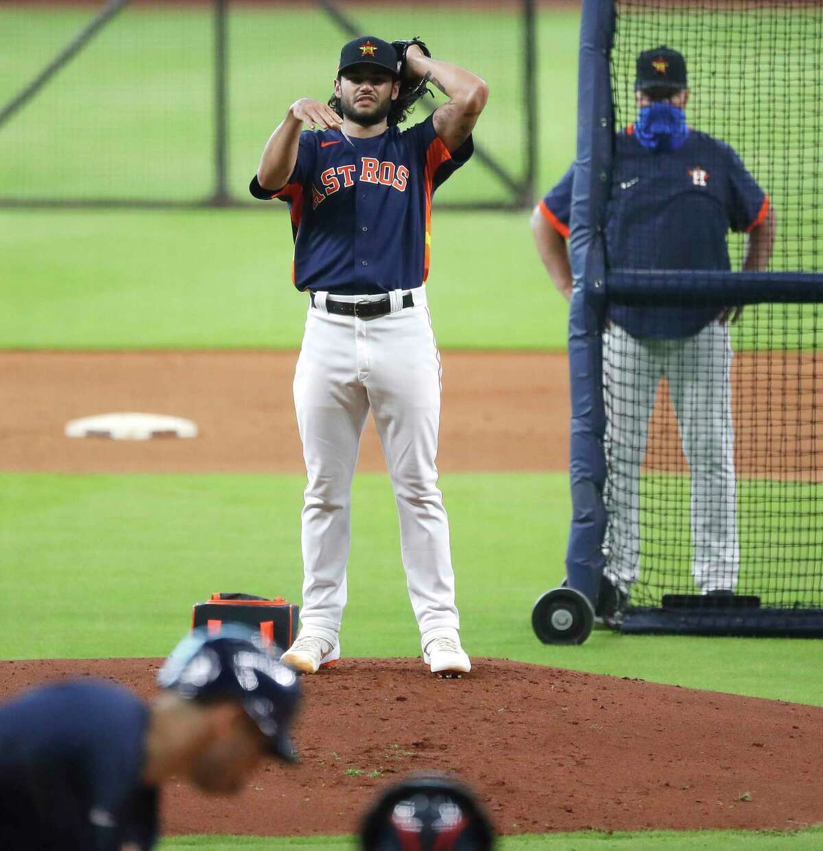 Houston Astros starting pitcher Lance McCullers Jr. throws a live batting practice during the Astros summer camp at Minute Maid Park, Saturday, July 4, 2020, in Houston.