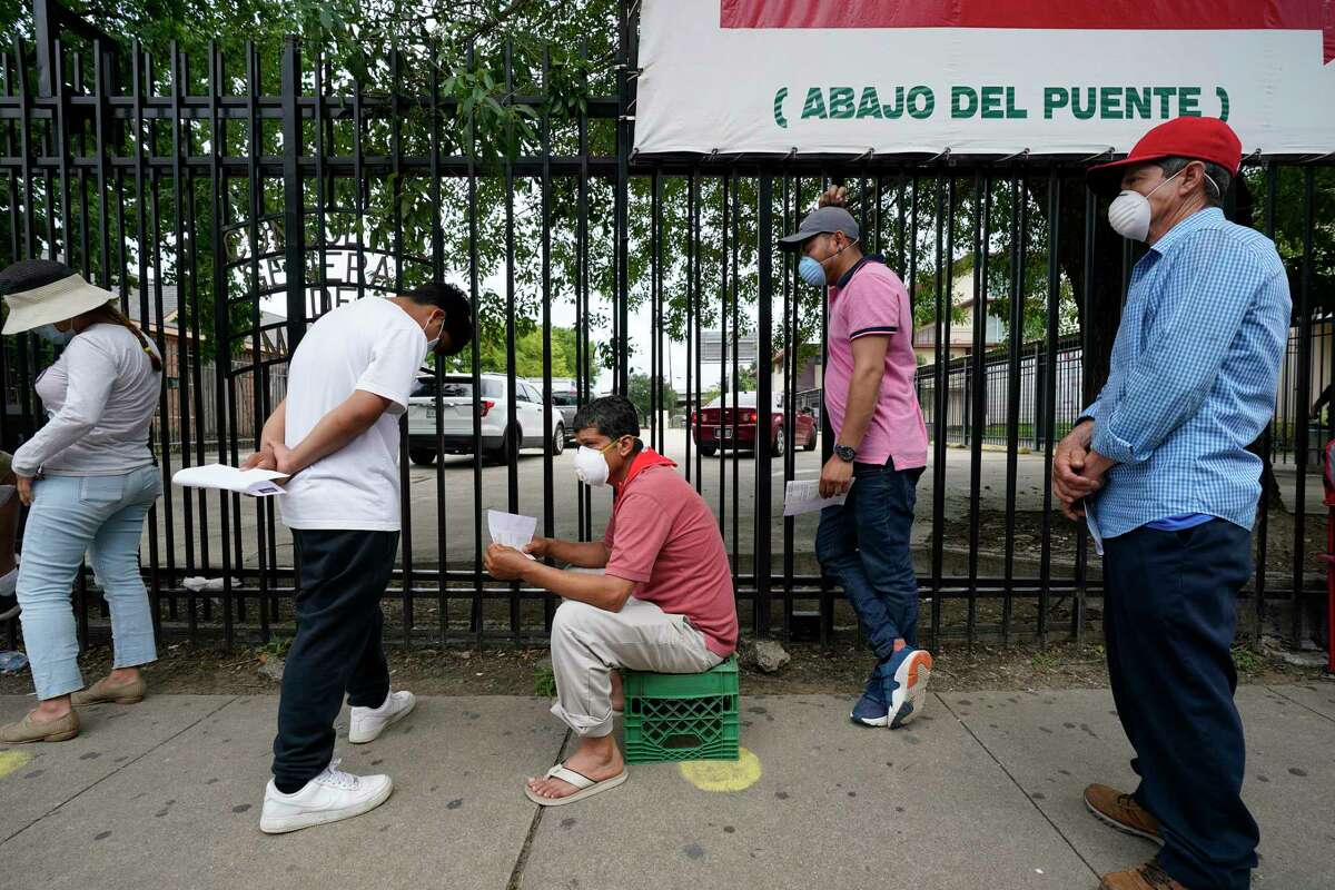 People wait in line for free COVID-19 testing conducted by United Memorial Medical Center at the Consulate General Of Mexico, 4506 Caroline St., Sunday, June 28, 2020, in Houston.