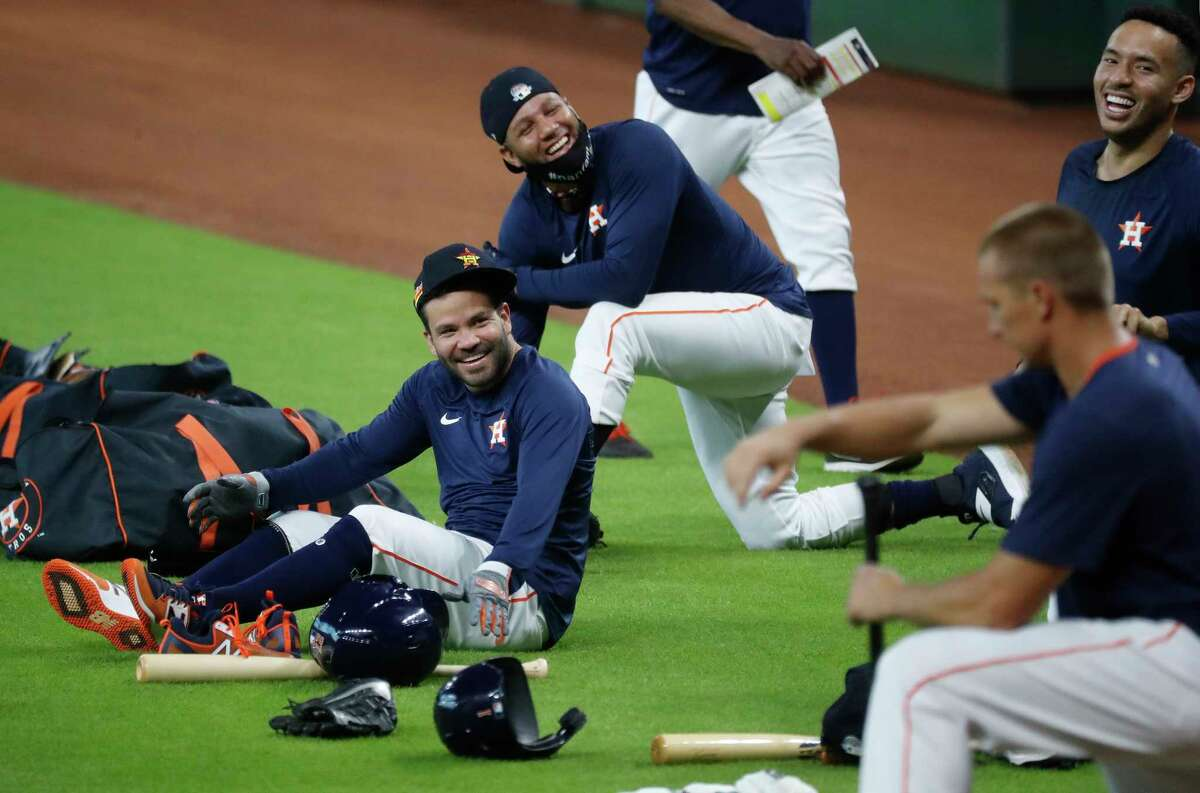 Houston Astros second baseman Jose Altuve, Yuli Gurriel, and Carlos Correa laugh during the Astros summer camp at Minute Maid Park, Saturday, July 4, 2020, in Houston.