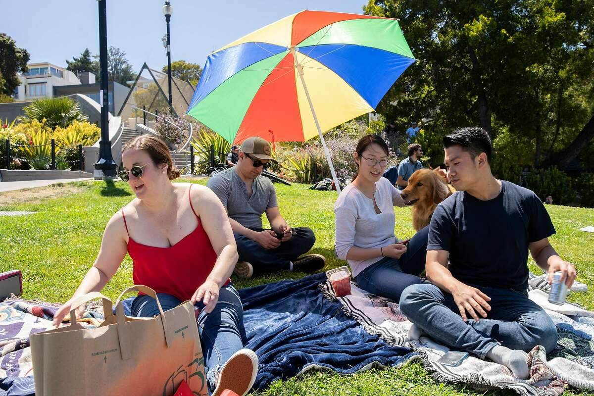 Friends at Dolores Park on Saturday, July 4, 2020, in San Francisco, Calif.