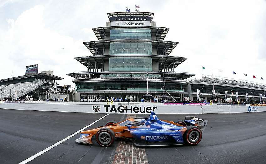 Scott Dixon, driver of the #9 PNC Bank Chip Ganassi Racing Honda, crosses the finish line to win the NTT IndyCar Series GMR Grand Prix at Indianapolis Motor Speedway on Saturday.