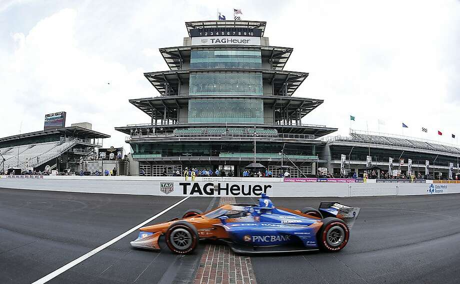 Scott Dixon, driver of the #9 PNC Bank Chip Ganassi Racing Honda, crosses the finish line to win the NTT IndyCar Series GMR Grand Prix at Indianapolis Motor Speedway on Saturday. Photo: Jamie Squire / Getty Images