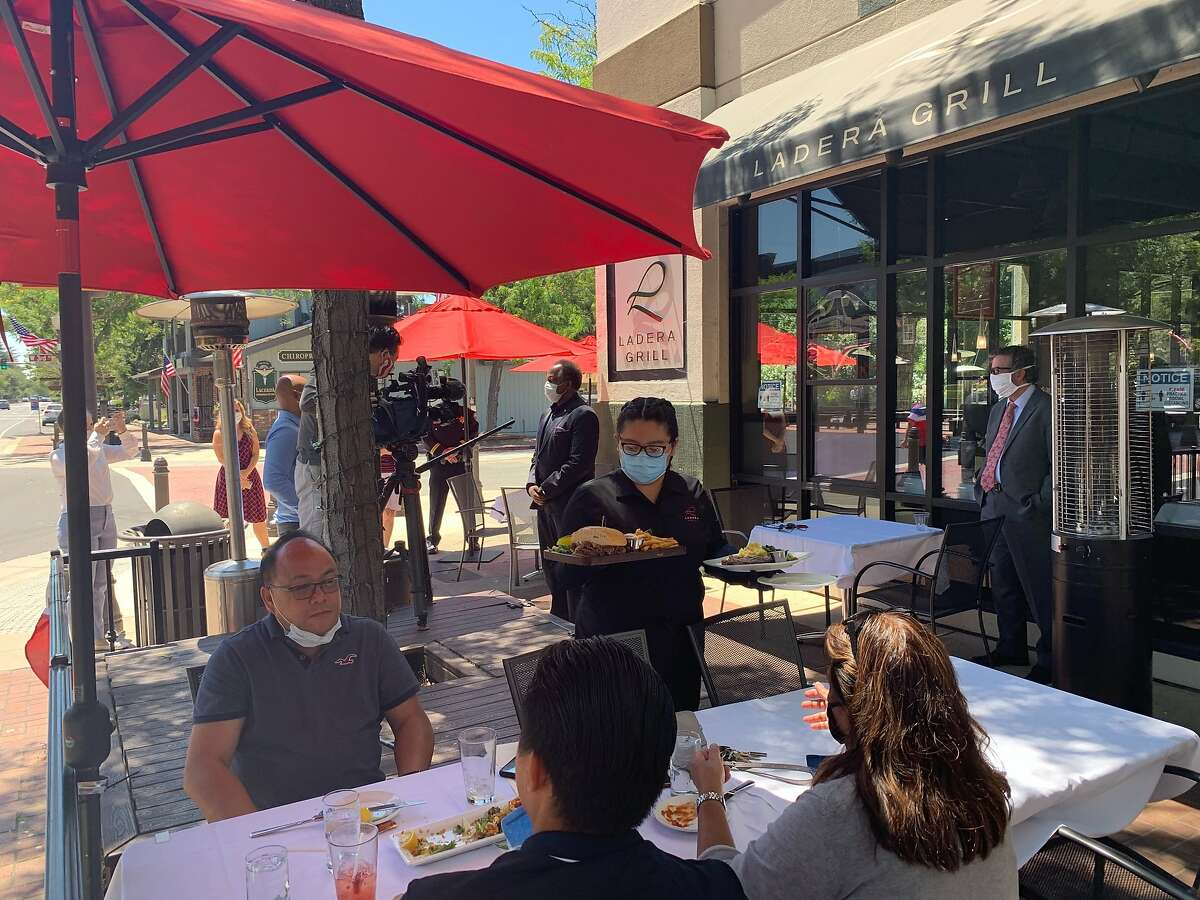 Patrons fine outdoors at Ladera Grill in Morgan hill on Saturday, July 4, 2020. The restaurant continued to offer outdoor service despite threats of fines from the state department of Alcohol Beverage Control.