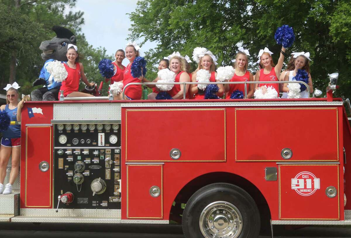 The city of Friendswood has as video highlighting its unique approach to this year's Fourth of July - seven miniparades that went through various neighborhoods. Here, Friendswood High School cheerleaders rev up residents along Parade Route No. 4.