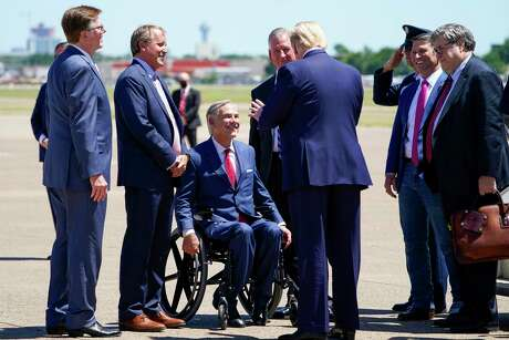 (from left) Texas Lt. Gov. Dan Patrick, Attorney General Ken Paxton and Gov. Greg Abbott greet President Donald Trump at Dallas Love Field on Thursday, June 11, 2020, in Dallas. (Smiley N. Pool/The Dallas Morning News)