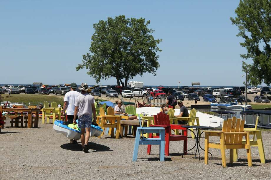 Port Austin came alive on Saturday as the streets were lined up for the Fourth of July parade. The beaches and Lake Huron waters also saw their fair share of people enjoying the weather. Photo: Robert Creenan/Huron Daily Tribune