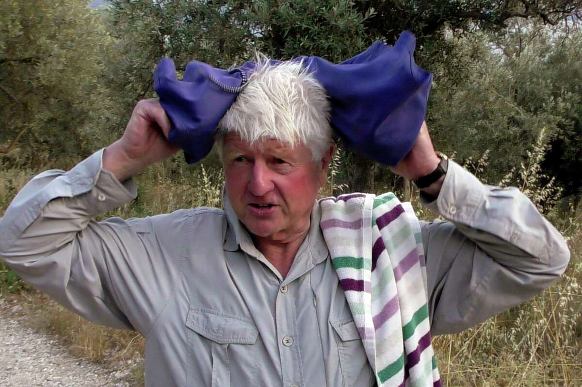 Stanley Johnson, father of Britain's Prime Minister Boris Johnson, speaks with local reporters outside his Villa Irene in Horto village, Mount Pelion (also known as Pilio), central Greece, Friday, July 3, 2020. Stanley Johnson, arrived in Athens on Wednesday evening after flying via Bulgaria due to a current ban on direct flights from the Britain, before visiting his villa on Mount Pelion. (Dimitris Kareklidis/magnesianews.gr via AP)