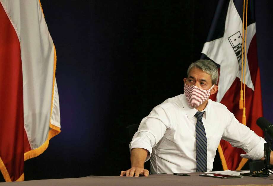 Mayor Ron Nirenberg wears his mask after a briefing that reported alarmingly high numbers of positive Covid-19 results on Tuesday, June 30, 2020. The mayor, Bexar County Judge Nelson Wolff and Dr. Colleen Bridger, assistant city manager, gave the daily city-county briefing on the latest coronavirus numbers. There were 1,268 new cases which gives the Bexar County and the city 12,065 confirmed positive cases of Covid-19. Judge Wolff will enact an order that will require businesses to screen customers with questions and a temperature check before entering their establishment. Photo: Kin Man Hui, San Antonio Express-News / Staff Photographer / **MANDATORY CREDIT FOR PHOTOGRAPHER AND SAN ANTONIO EXPRESS-NEWS/NO SALES/MAGS OUT/ TV OUT