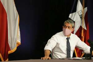 Mayor Ron Nirenberg wears his mask after a briefing that reported alarmingly high numbers of positive Covid-19 results on Tuesday, June 30, 2020. The mayor, Bexar County Judge Nelson Wolff and Dr. Colleen Bridger, assistant city manager, gave the daily city-county briefing on the latest coronavirus numbers. There were 1,268 new cases which gives the Bexar County and the city 12,065 confirmed positive cases of Covid-19. Judge Wolff will enact an order that will require businesses to screen customers with questions and a temperature check before entering their establishment.