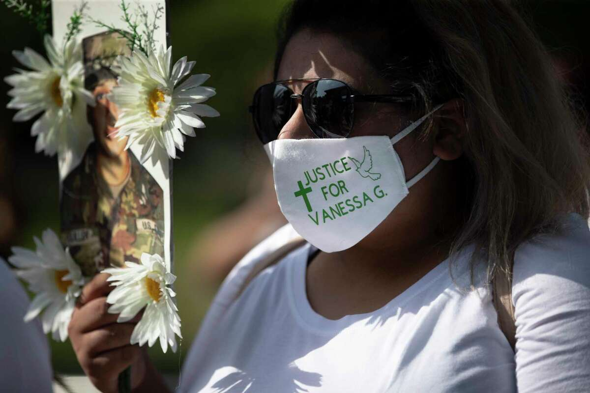 A woman wears a protective masks that has a message demanding justice for Vanessa Guillen on Saturday, July 4, 2020, in Houston. Army Pfc. Vanessa Guillen, 20, who went missing in April was presumably killed by a fellow soldier.