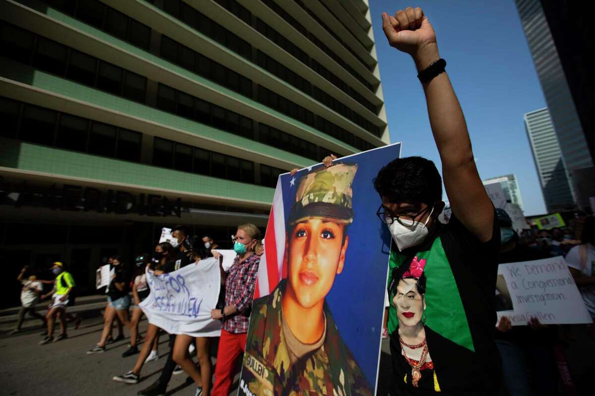 Protestor Ivan Lara, 28, marches carrying an oversize photograph of Army Pfc. Vanessa Guillen, 20, on Saturday, July 4, 2020, in Houston. Guillen was presumably murdered by a fellow soldier. The case is under investigation.