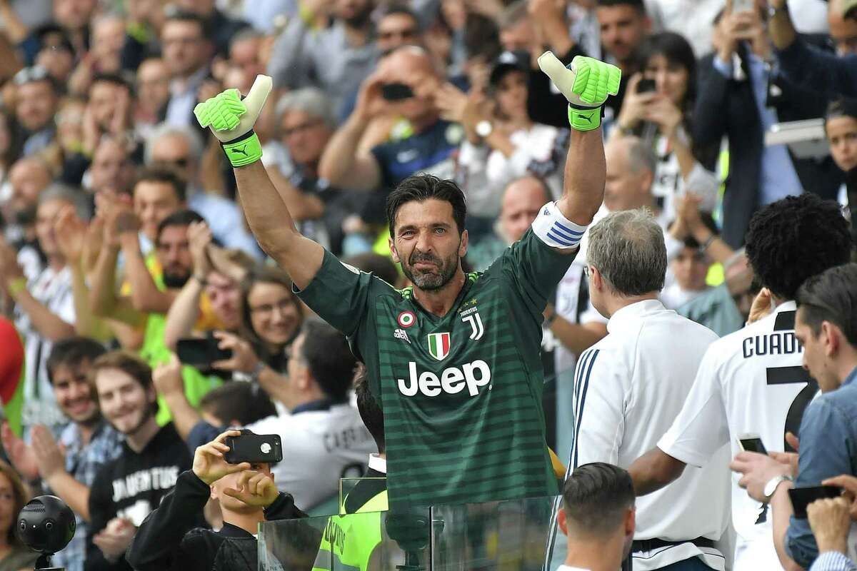 (FILES) In this file photo taken on May 19, 2018 Juventus' goalkeeper from Italy Gianluigi Buffon reacts as he leaves the pitch for his last game with Juventus team during the Italian Serie A football match Juventus versus Verona, at the Allianz Stadium in Turin. - The legendary Italian goalkeeper Gianluigi Buffon should become on July 4, 2020 the sole holder of the record for the number of games played in Serie A with 648 appointment with Italian football team Juventus. (Photo by MARCO BERTORELLO / AFP) (Photo by MARCO BERTORELLO/AFP via Getty Images)