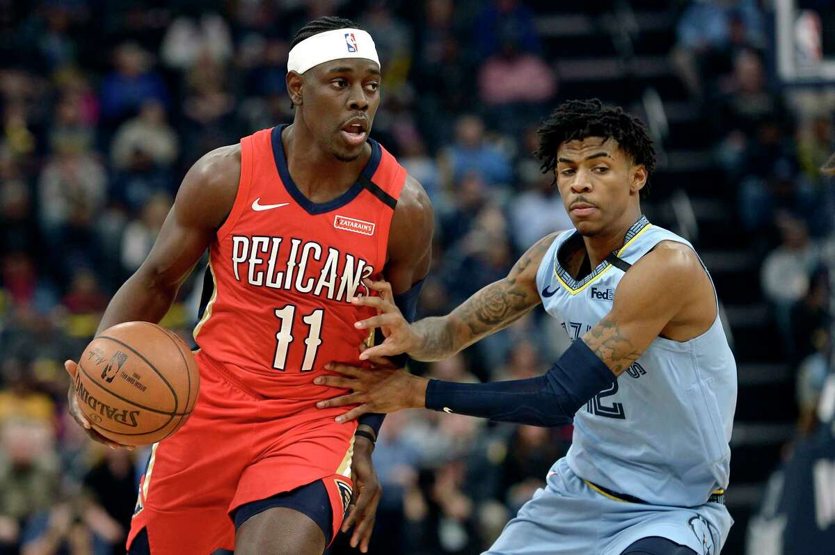 FILE - In this Monday, Jan. 20, 2020 file photo, New Orleans Pelicans guard Jrue Holiday (11) handles the ball against Memphis Grizzlies guard Ja Morant in the first half of an NBA basketball game in Memphis, Tenn. The unusual resumption of the NBA season during the coronavirus pandemic is making mental health a priority. Pelicans guard Jrue Holiday expects basketball to be the easy part of living in the NBAa€™s a€œbubblea€ when 22 teams gather in Central Florida to resume their suspended seasons later this month. (AP Photo/Brandon Dill, File)