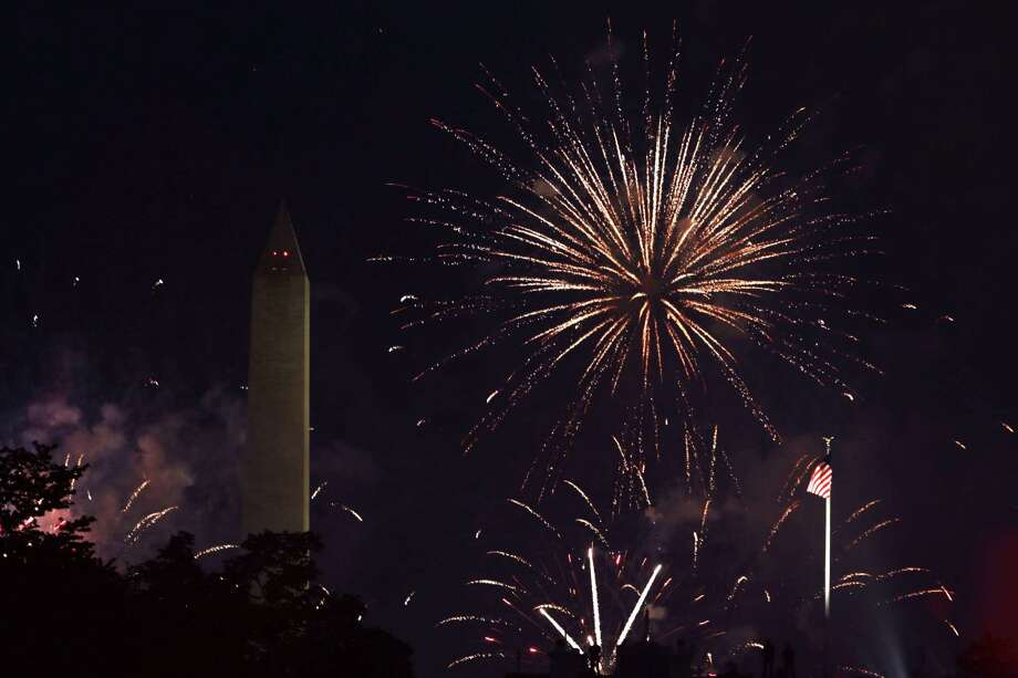 WASHINGTON, DC - JULY 04:  Fireworks explode near the Washington Monument July 4, 2020 in Washington, DC. Anti-Trump activists rallied on Independence Day at Black Lives Matter Plaza near the White House to voice their disapproval of President Trump's handling in the wake of the death of George Floyd.  (Photo by Alex Wong/Getty Images) Photo: Alex Wong / 2020 Getty Images