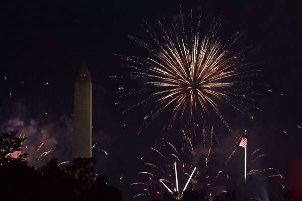 WASHINGTON, DC - JULY 04: Fireworks explode near the Washington Monument July 4, 2020 in Washington, DC. Anti-Trump activists rallied on Independence Day at Black Lives Matter Plaza near the White House to voice their disapproval of President Trump's handling in the wake of the death of George Floyd. (Photo by Alex Wong/Getty Images)
