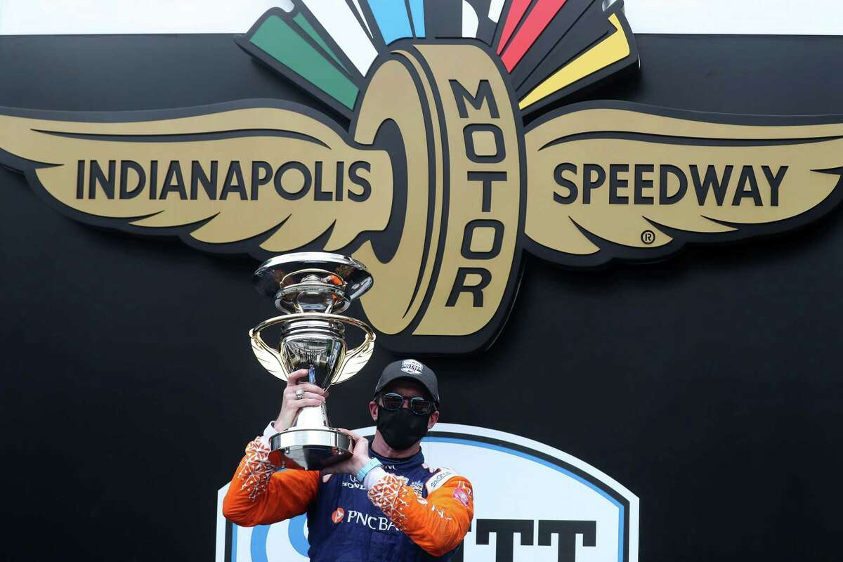 INDIANAPOLIS, INDIANA - JULY 04: Scott Dixon, driver of the #9 PNC Bank Chip Ganassi Racing Honda, celebrates in Victory Lane after winning the NTT IndyCar Series GMR Grand Prix at Indianapolis Motor Speedway on July 04, 2020 in Indianapolis, Indiana. (Photo by Chris Graythen/Getty Images)
