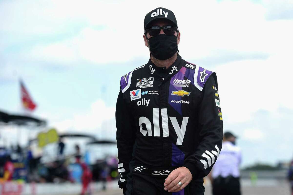 LONG POND, PENNSYLVANIA - JUNE 28: Jimmie Johnson, driver of the #48 Ally Chevrolet, walks on the grid prior to the NASCAR Cup Series Pocono 350 at Pocono Raceway on June 28, 2020 in Long Pond, Pennsylvania. (Photo by Jared C. Tilton/Getty Images)