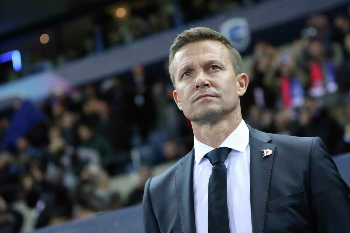 FILE - In this file photo dated Wednesday, Nov. 27, 2019, Salzburg soccer coach Jesse Marsch stands on the sidelines during a Champions League group E soccer match against Genk at the KRC Genk Arena in Genk, Belgium. Marsch led Salzburg to this seasona€™s Austrian league title, the most significant trophy won by an American coach in Europe, and says he wanted