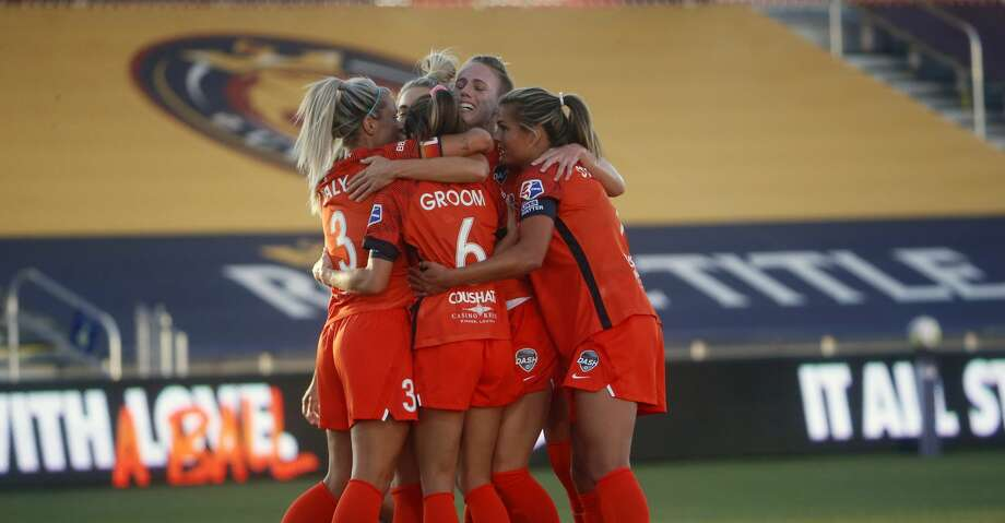 Houston Dash players celebrate after Kristie Mewis' goal against OL Reign during the first half of an NWSL Challenge Cup soccer match at Zions Bank Stadium on Saturday, July 4, 2020, in Herriman, Utah. (AP Photo/Rick Bowmer) Photo: Rick Bowmer/Associated Press / Copyright 2020 The Associated Press. All rights reserved