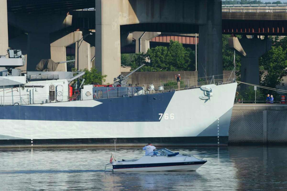 A boater on the Hudson River takes photos of the USS Slater before it departed on Sunday, July 5, 2020, in Albany, N.Y.