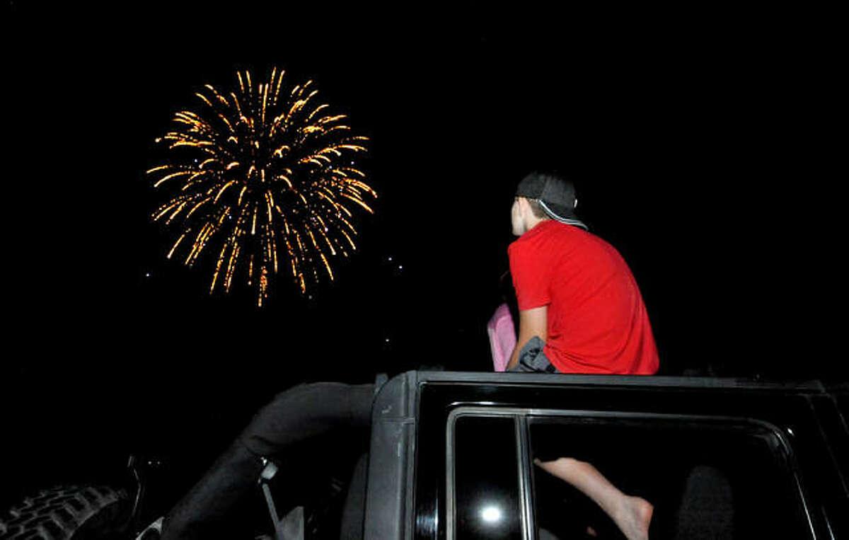 Tyler Wolff, 13, of Edwardsville watches fireworks at Edwardsville High School Friday night.