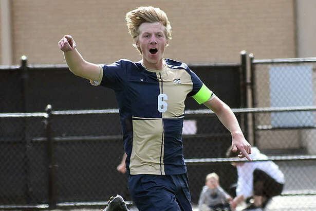 Father McGivney's Jonah Mitan shouts to the bench after scoring in the 51st minute against Althoff in the Class 1A Althoff Regional championship game in Belleville.