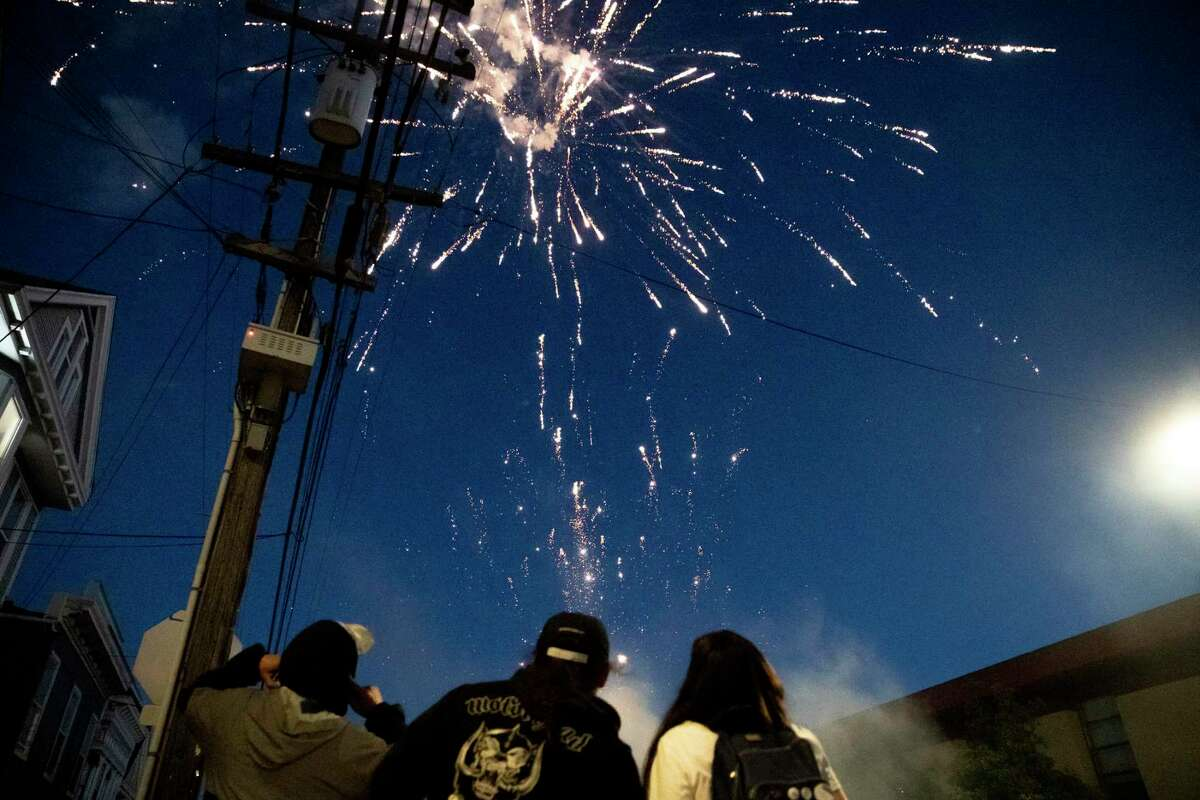 Fireworks ignite on Independence Day in the Potrero Hill neighborhood of San Francisco.