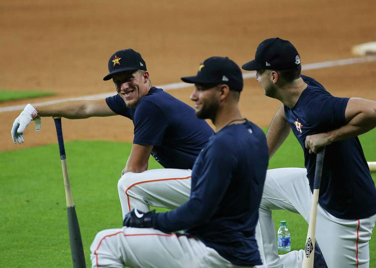 Houston Astros outfielders Myles Straw and Kyle Tucker, back, are cracked up by first baseman Yuli Gurriel during the Astros summer camp Sunday, July 5, 2020, at Minute Maid Park in Houston.