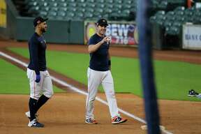 Houston Astros outfielders George Springer and Josh Reddick heading back to the dugout during the Astros summer camp Sunday, July 5, 2020, at Minute Maid Park in Houston.