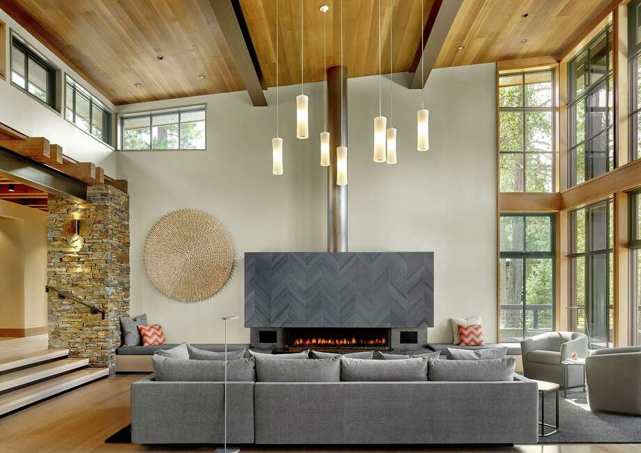 Clerestory windows help illuminate this living room conceptualized by Y.A. Studio that's warmed by a gas fireplace with a herringbone-patterned mantlepiece. Photo: César Rubio
