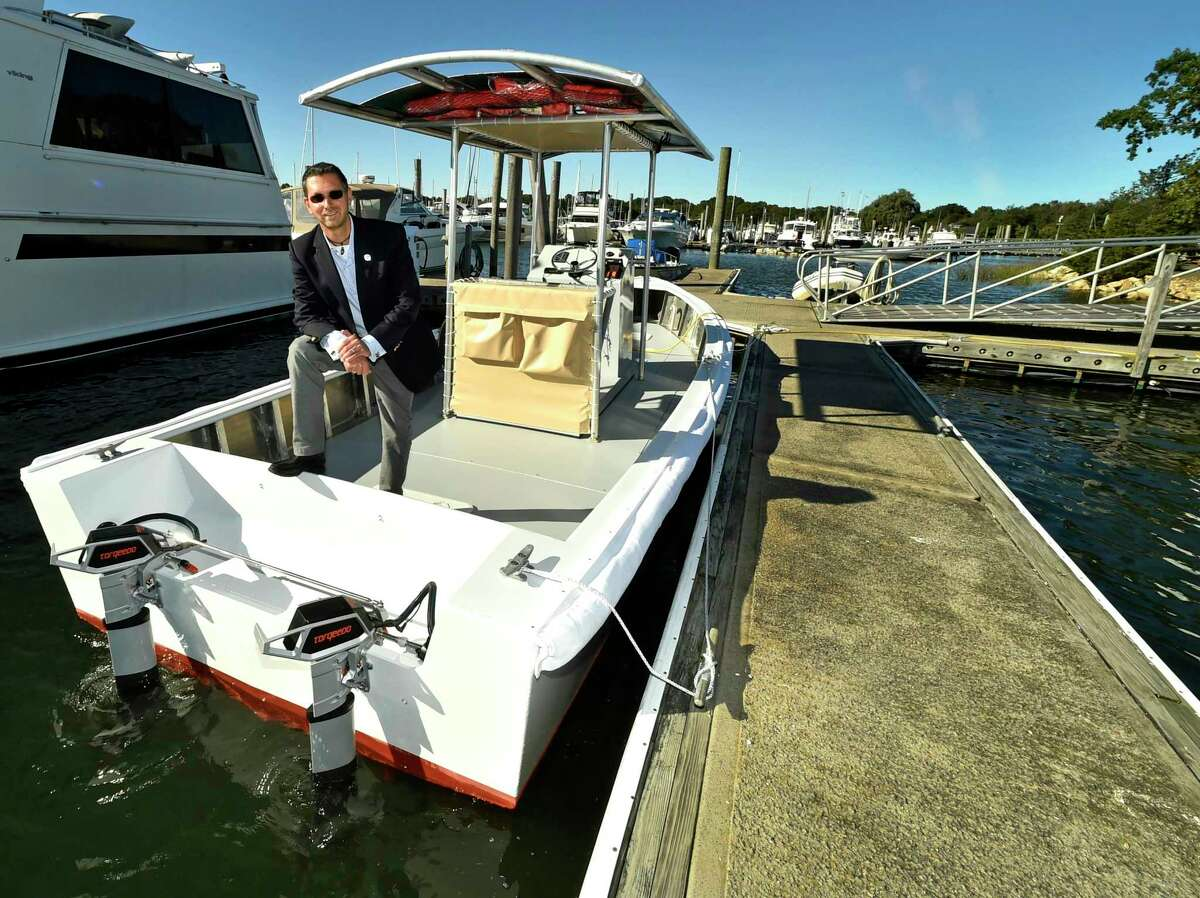 Michael Pascucilla, director of Health for the East Shore District Health Department, on what in 2018 was the world's first full-size, fully electric, zero carbon emissions, solar-powered pump-out vessel at the Bruce & Johnson's Marina in Branford.