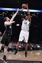 LaMarcus Aldridge, shooting over Tyler Zeller when Zeller was with the Nets in 2018, was the Spurs' top rebounder and shot blocker when season was stopped.