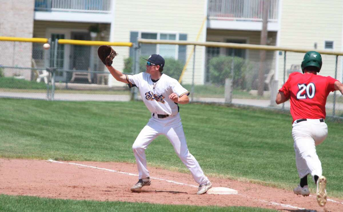 Saints first baseman Braedan Lundquist catches a force out during Manistee's doubleheader against the Northern Michigan Dogmen Saturday at Rietz Park. (Kyle Kotecki/News Advocate)