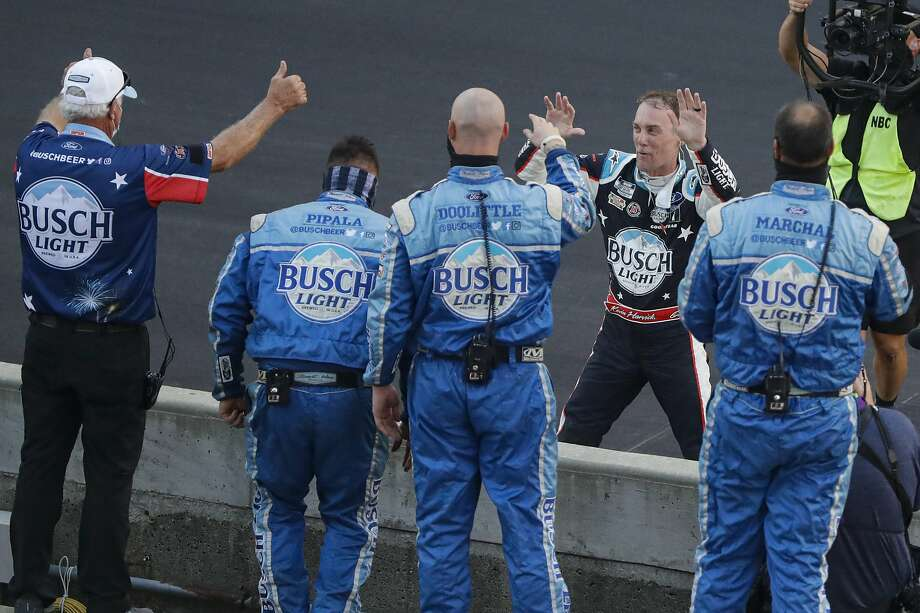 Kevin Harvick, on the far side of wall, won a NASCAR race in Indianapolis after beating Matt Kenseth off the final restart. Photo: Darron Cummings / Associated Press