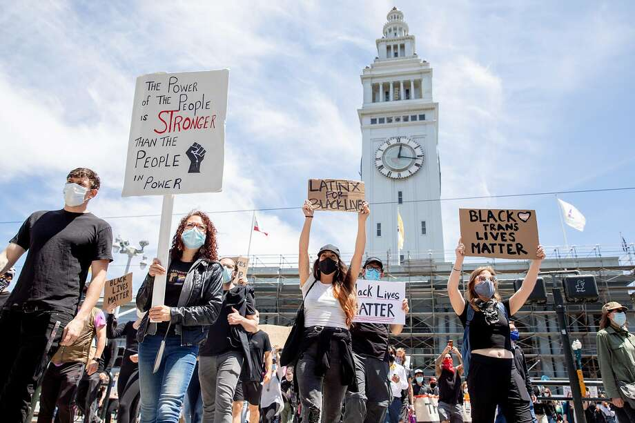 Demonstrators protest in June front of the Ferry Building in San Francisco. Photo: Jessica Christian / The Chronicle