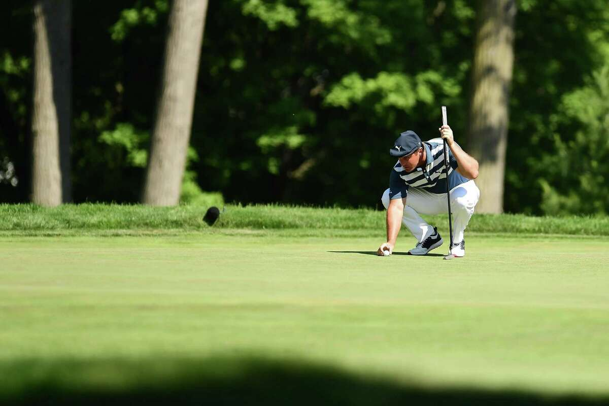 DETROIT, MICHIGAN - JULY 05: Bryson DeChambeau of the United States lines up a putt on the 12th green during the final round of the Rocket Mortgage Classic on July 05, 2020 at the Detroit Golf Club in Detroit, Michigan. (Photo by Stacy Revere/Getty Images)