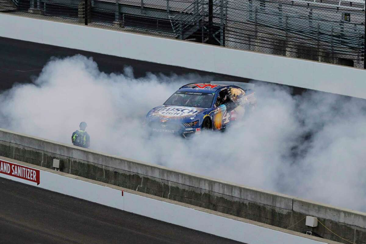 Kevin Harvick does a burnout after winning the NASCAR Cup Series auto race at Indianapolis Motor Speedway in Indianapolis, Sunday, July 5, 2020. (AP Photo/Darron Cummings)