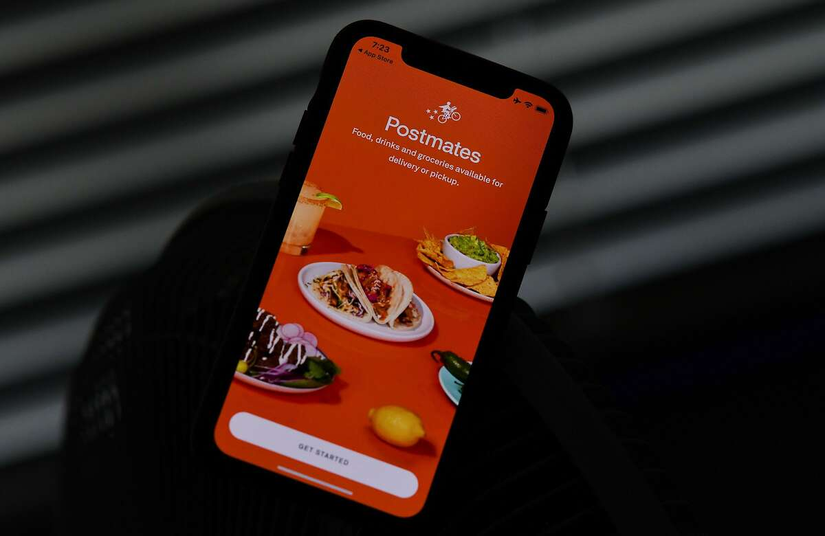 This illustration photo taken on June 30, 2020 shows the delivery app Postmates on a smartphone screen in Los Angeles. - Uber is in talks to buy food delivery app Postmates in a multibillion dollar deal, US media reported. (Photo by Chris DELMAS / AFP) (Photo by CHRIS DELMAS/AFP via Getty Images)