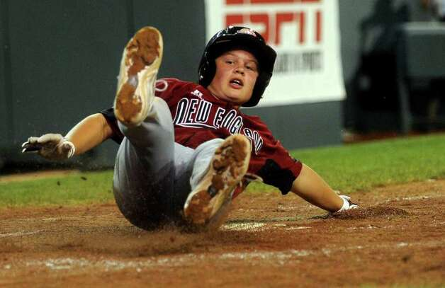 Jack Quinn slides across home plate, scoring a run during Tuesday's game in the Little League World Series in Williamsport, Pennsylvania. Photo: Lindsay Niegelberg / Connecticut Post