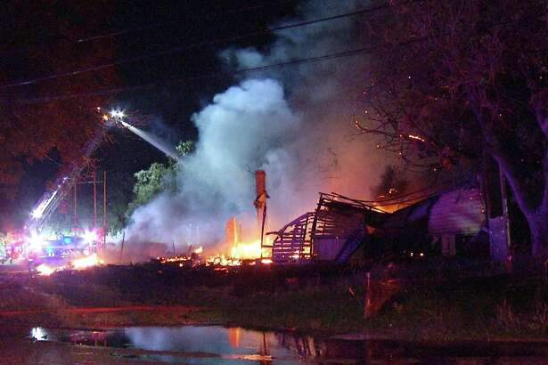 A Southwest Side home was destroyed Sunday night and several others damaged after several structures went up in flames.