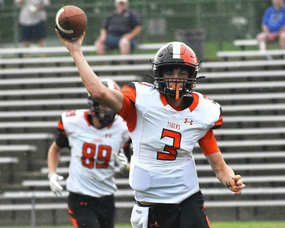 Edwardsville quarterback Ryan Hampton delivers a pass during last year's season opener against McCluer North. Photo: Matt Kamp|The Intelligencer