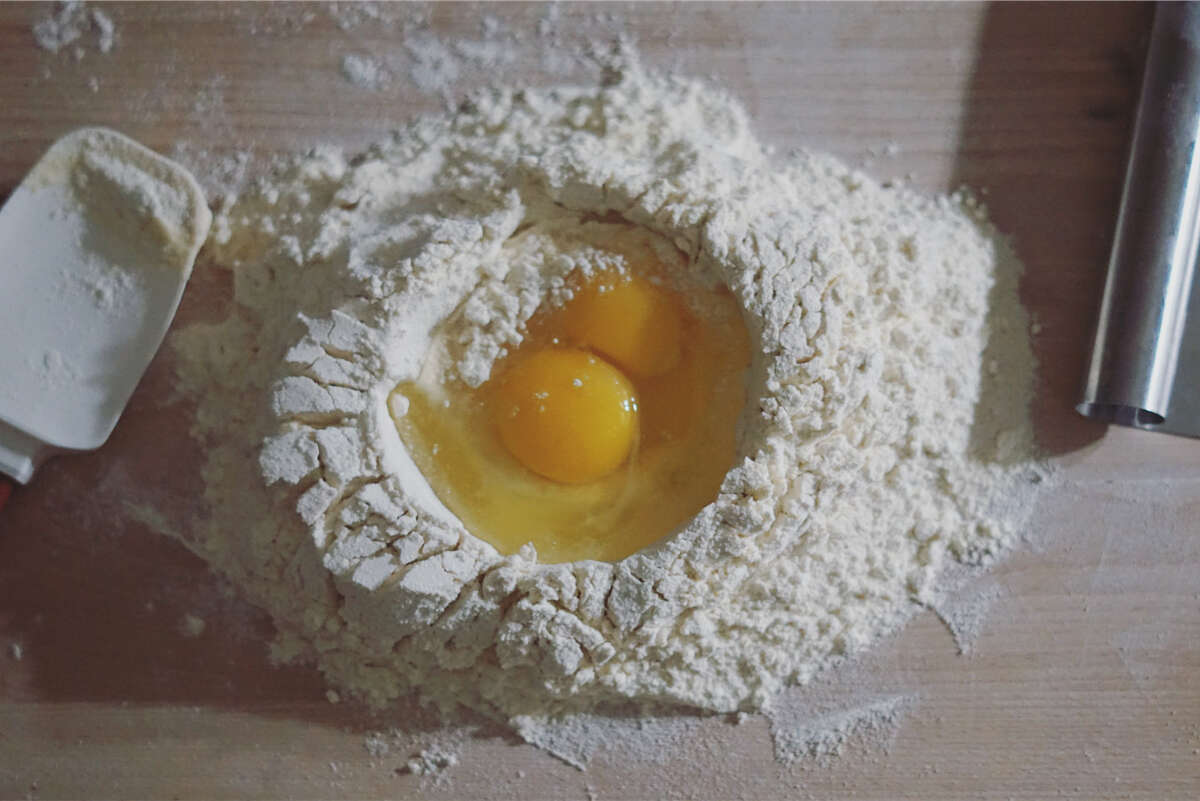 Writer Stephanie Gravalese marks progress in learning how to make 100 pasta shapes via her Instagram page. Here, eggs in a well of flour to make the pasta dough.